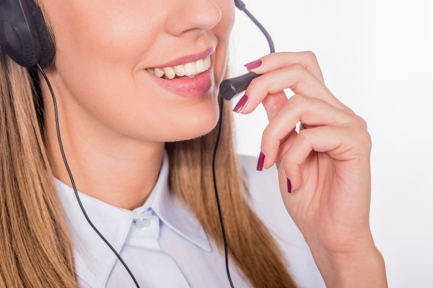 beautiful young call center assistant smiling isolated 1391 14 - Contact MAK Corp
