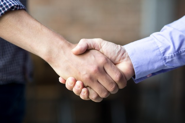 closeup of two business men shaking hands 1262 3740 - closeup-of-two-business-men-shaking-hands_1262-3740